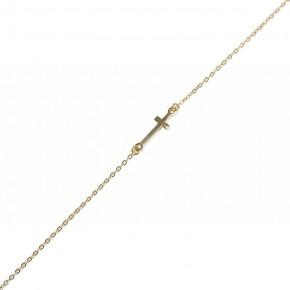 Minimalistyczny złoty łańcuszek z subtelnym krzyżykiem